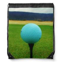 white Golf Ball on a mountain golf course Drawstring Bag
