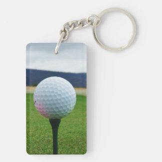 white Golf Ball on a mountain golf course Acrylic Key Chain