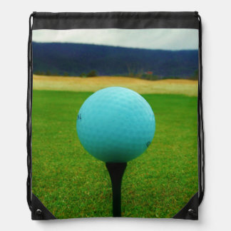 white Golf Ball on a mountain golf course Drawstring Backpacks