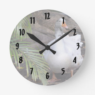 White Goose standing near fronds Round Clock