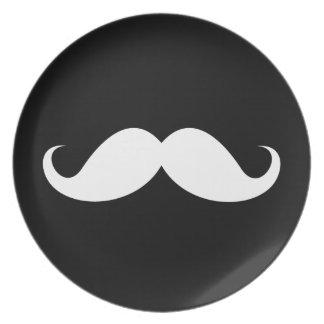 White handlebar mustache on black background plate