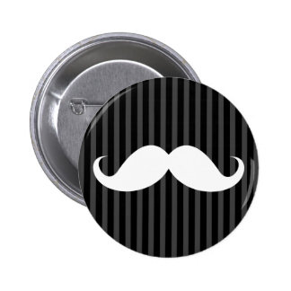 White handlebar mustache on gray black stripes pinback button
