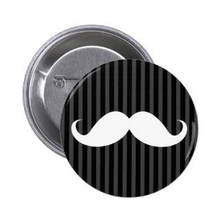 White handlebar mustache on gray black stripes pinback button