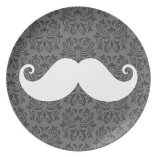 White handlebar mustache on gray damask pattern dinner plate
