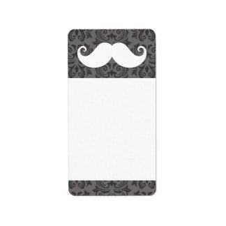 White handlebar mustache on gray damask pattern label