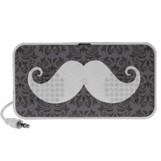 White handlebar mustache on gray damask pattern notebook speakers