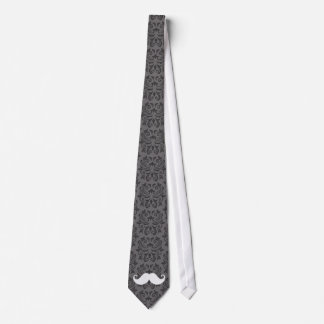 White handlebar mustache on gray damask pattern tie