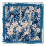 White heather flowers on a marble stone trivet