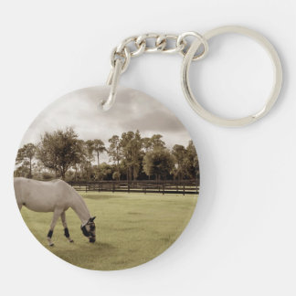 white horse in pasture grazing old style keychain