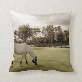 white horse in pasture grazing old style throw pillow