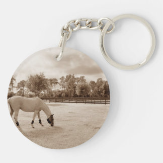 white horse in pasture grazing sepia keychain