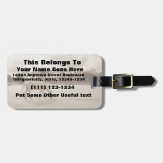 white horse in pasture grazing sepia tags for luggage