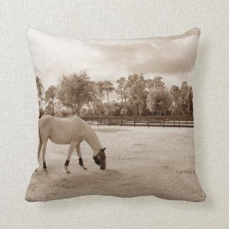 white horse in pasture grazing sepia throw pillow