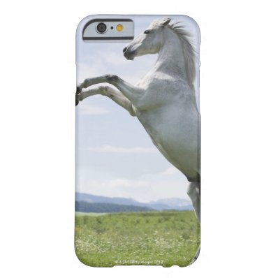 white horse jumping on meadow barely there iPhone 6 case