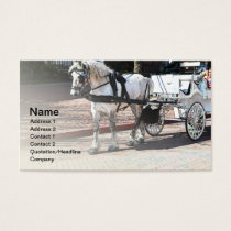 white horse pulling a white carriage business card