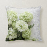 white hydrangeas with script writing pillow