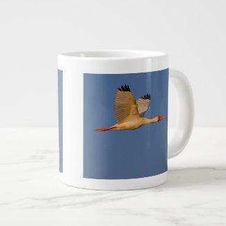 white ibis in flight giant coffee mug