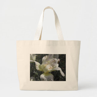 White iris flower with droplets in spring large tote bag