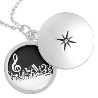 White Jumbled Musical Notes on Black Round Locket Necklace