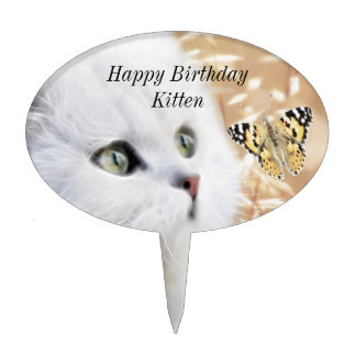 White kitten and butterfly cake topper