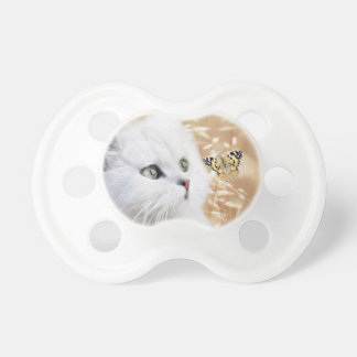 White kitten and butterfly pacifier