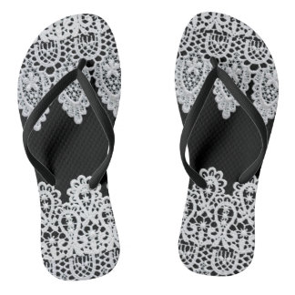 White lace forms a delicate border against black flip flops