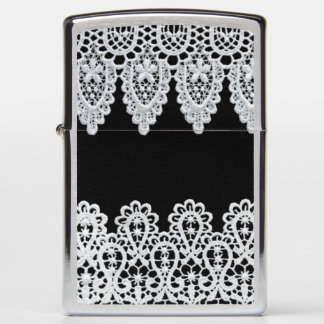 White lace forms a delicate border against black zippo lighter
