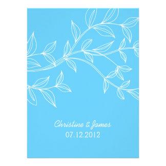 White leaves on blue wedding invitation