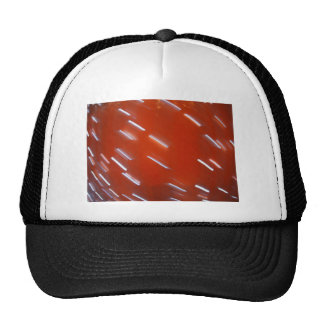 White LED light bulb on a red wall blurred in moti Trucker Hat