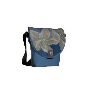 white lilies on blue messenger bag