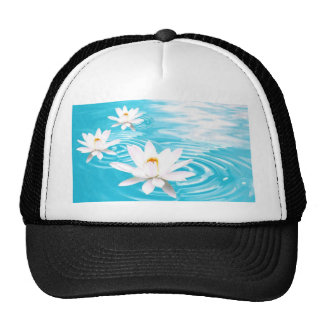 White Lotus plants floating on turquoise water zen Mesh Hats