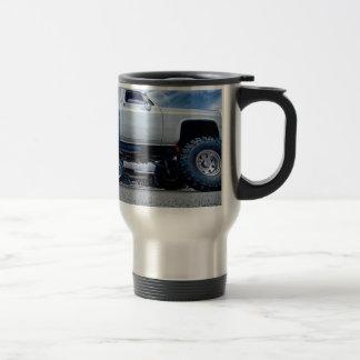 white monster truck travel mug