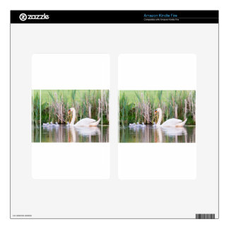 White mother swan swimming with chicks kindle fire skin