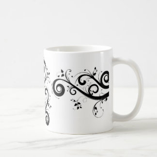 white mug with black swirl pattern