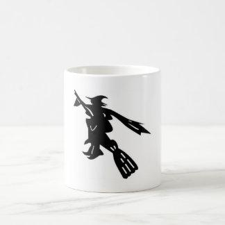 white mug with black witch
