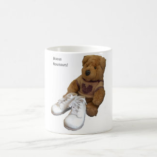 White mug with cute teddy and baby shoes