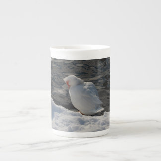 white Muscovy duck in the snow Tea Cup