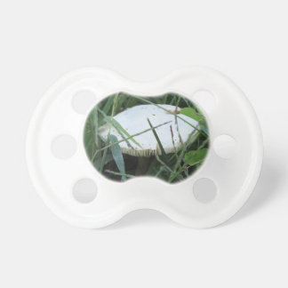 White mushroom on a green meadow BooginHead pacifier