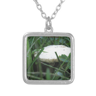 White mushroom on a green meadow silver plated necklace