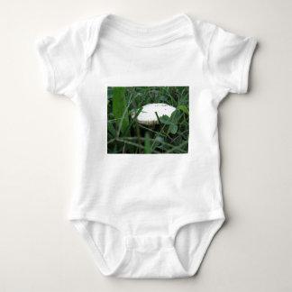 White mushroom on a green meadow tshirt