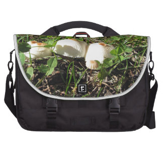 White mushrooms on green background commuter bags