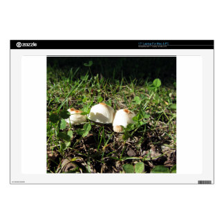 White mushrooms on green background laptop skin