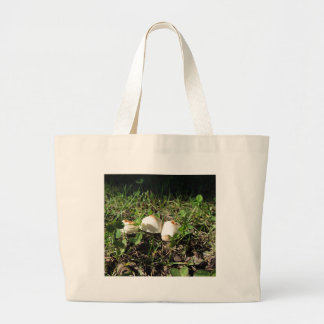 White mushrooms on green background large tote bag