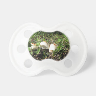 White mushrooms on green background BooginHead pacifier