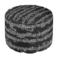 white musical notes on black round pouf