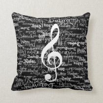 white pattern of names & treble clef, on black throw pillow