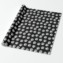 white paw print pattern on black background wrapping paper