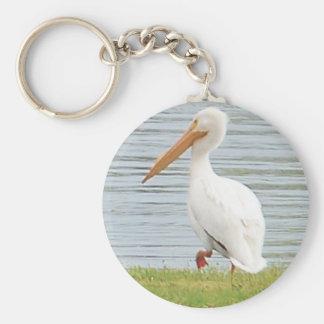 white pelican along shoreline basic round button keychain
