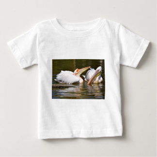 White pelicans on the water baby T-Shirt