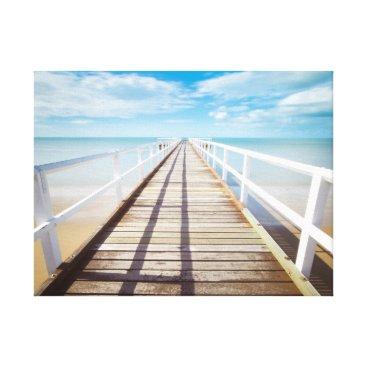 Beach Themed White pier on the ocean coast canvas print
